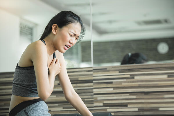 Asian-woman-having-heart-attack-after-workout.-684958042_1256x838