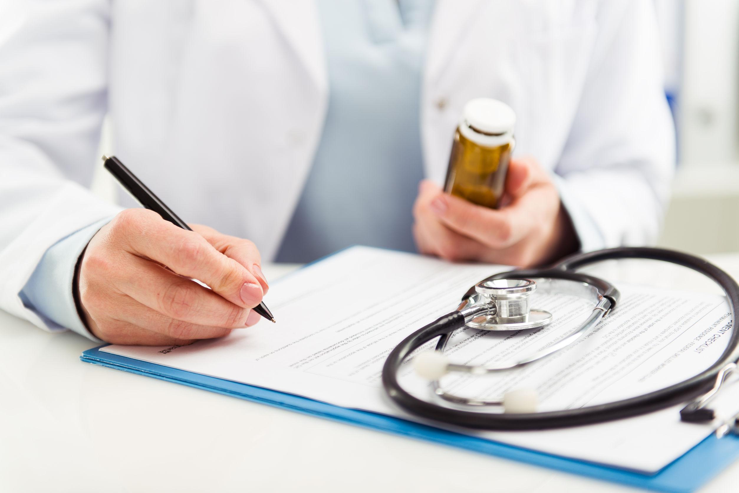 Doctor prescribing medications for patient