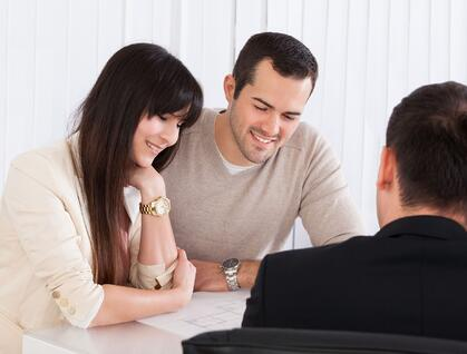 Young couple is discussing about international health insurance with an agent