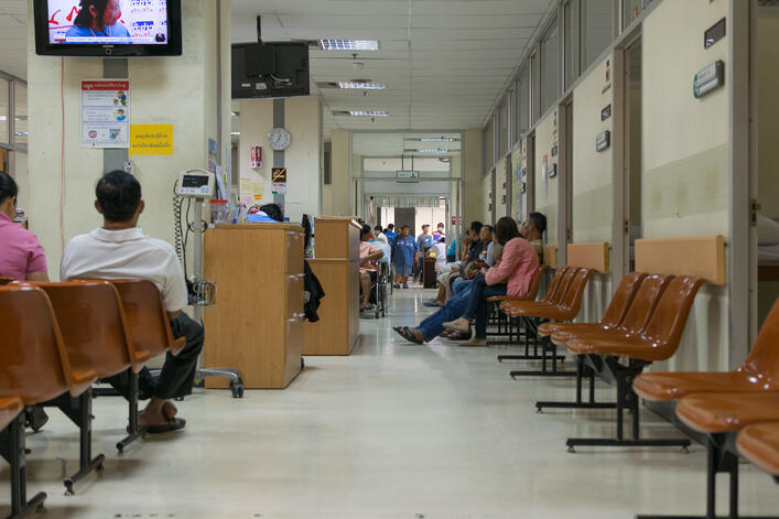 patients with government health care waiting to see the doctors in a government hospital in Thailand