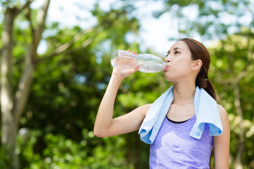 exercise woman drinking water stay hydrated thailand