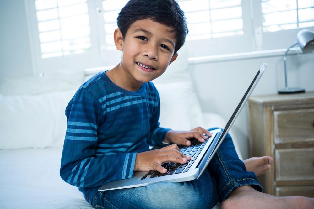 healthy boy using laptop