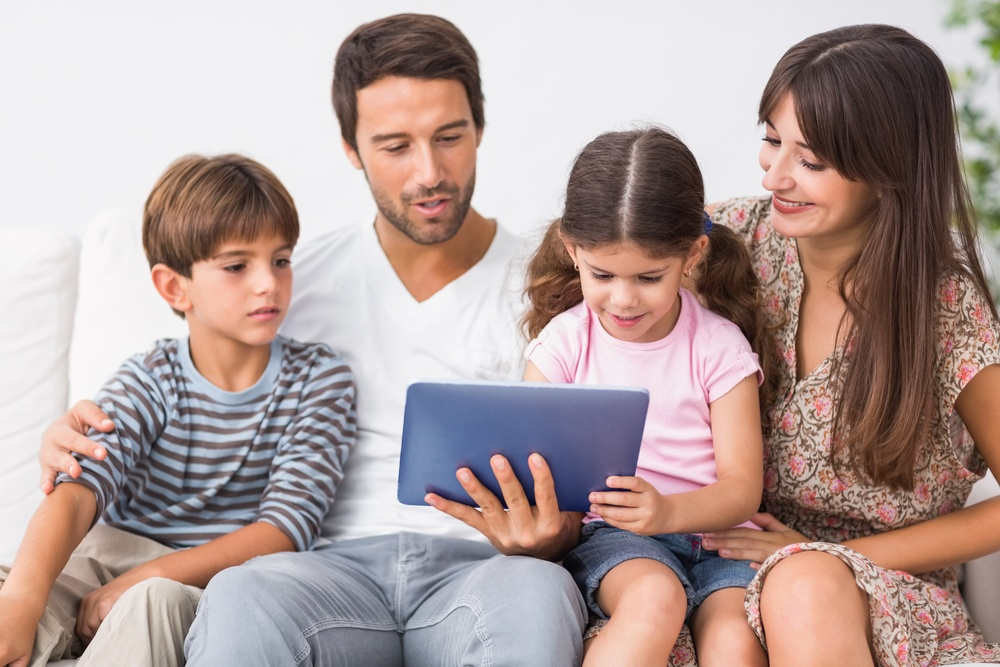 Happy family looking at tablet pc together