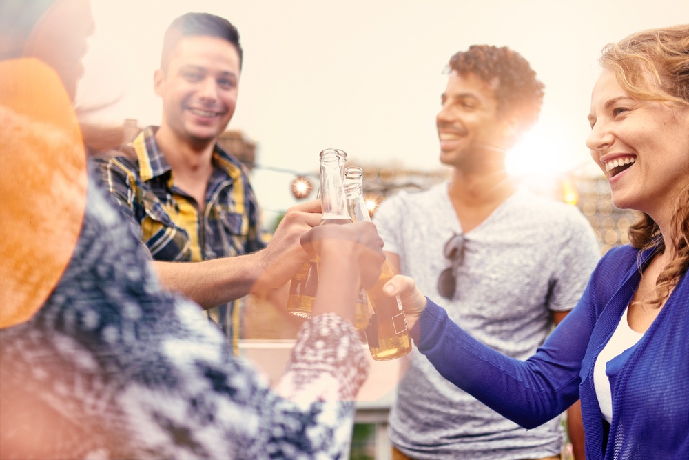 group of friends partying drinking alcohol health effects