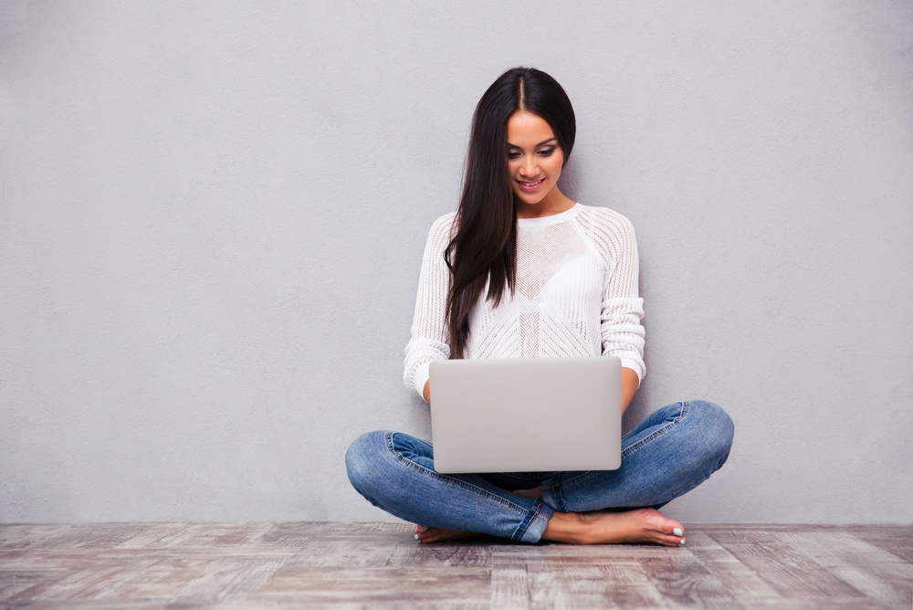 teenager on computer using social media