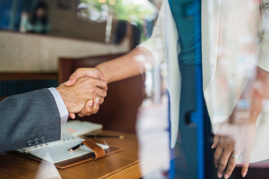 hand shake employee wellness hapiness